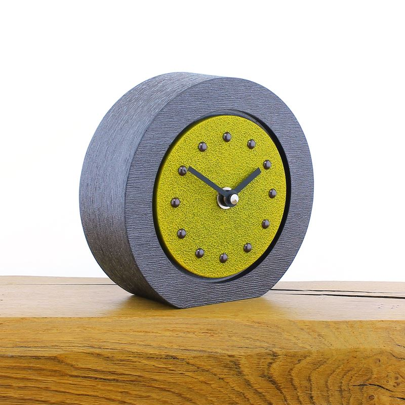 Round Yellow Mantel Clock, Pewter Frame, Antique Studs, Black Hands